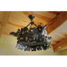 A wrought iron chandelier - an oak stump - an interior light (SI0313)