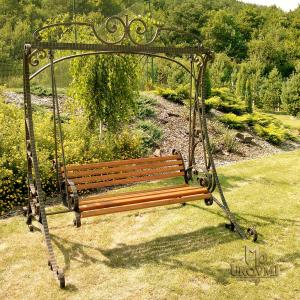 A  wrought iron rocking bench